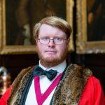 Rhys Headshot in Warden Gown