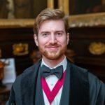 Samuel Headshot in Clerk Robe